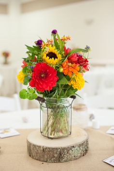 Rustic Wedding Centerpiece.. the flower combinations is very pretty minus the red flower.. it would be a rose instead!