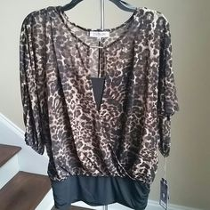 Elegant JLO Top A delicate and flowy, elegant overlapped sheer top. It looks like a two piece, but the hem hold the tank top underneath and the shell as one piece. The hem streches and the cuffs end with elasctic. It fit any body type Jennifer Lopez Tops
