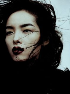 Dramatic dark brows. With dark lips. Fei Fei Sun photographed by Josh Olins for Vogue China November 2011.