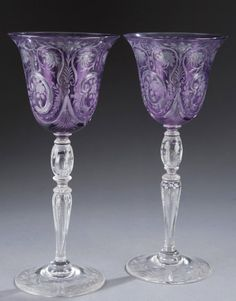Lot 177: Pair of Steuben purple etched glasses. Estimate: $300-$500.