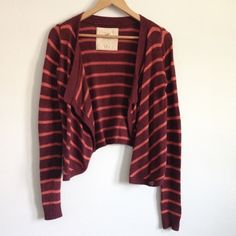 "Hollister Striped Maroon & Orange Cardigan Cute cardigan from Hollister. Very soft and warm. Features long sleeves, an asymmetrical hem and unique maroon / orange color combination. Gently worn, still in good condition! Measurements (laid flat) 19"" long in back, 25"" long in the front. Provides stretch. Hollister Sweaters Cardigans"