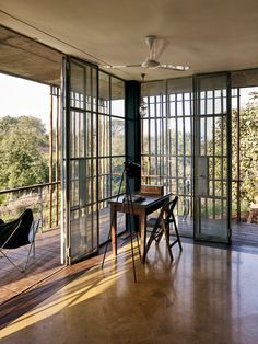 This weekend residence by Architecture Brio is half-embedded in the bank of a river that winds its way through the foothills of the Western Ghats, a mountain range bordering India's western coast