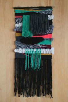 "Erika Sjogren / Jessen / 2014 Wool and cotton yarn on brass rod. Weaving is 18"" x 40"". Handwoven in California"
