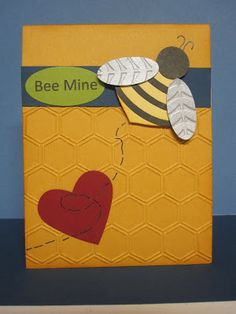 I used several punches to make the bee. The body is the ornament punch, head 3/4 circle punch, wings small oval punch, stripes on body large oval punch. For the wings I used brushed silver cardstock that I embossed with a new Sale a Bration folder. I thought the vines on the folder looked like wings.