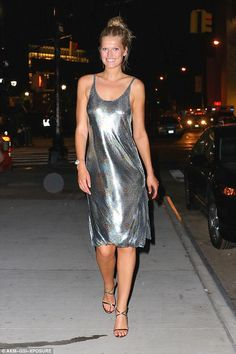Shimmering down the street: On Friday Toni Garrn stood out in a silver strappy dress as she left a Jimmy Choo party