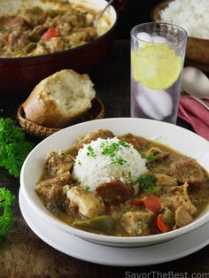 Gumbo is traditional Louisiana cuisine of spicy stew with chicken, andouille sausage, vegetables and herbs and spices. It is customary to serve gumbo with white rice.