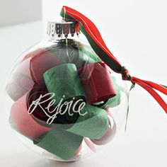 Rolled Cardstock Ornament  Design by Jlyne Hanback  Roll up variously colored cardstock strips and stuff them into a clear glass ball. Add a rub-on transfer to the outside of the ball and tie on pretty ribbons for a hanger.  Editor's Tip: Loosen too-tight coils with a pencil after you insert them into the glass ball.