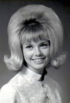 The True 60s Bouffant hairstyle ... the Higher the Better..... It used to drive my Mom Crazy!!