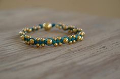Teal cord and gold beads DIY bracelet
