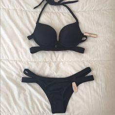 Victoria's Secret Banded Hottie Halter Victoria's Secret black swimsuit, new with tags, 34B top and M bottoms. The halter swim top is a push up. Victoria's Secret Swim Bikinis