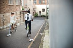 Bride and groom on #bicycles  #wedding