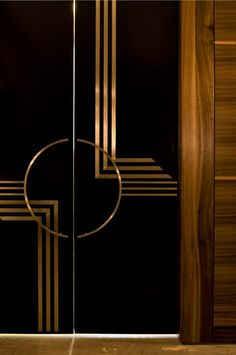 """Deco"" inspiration--dk lacquered wood w/ brass inlay, natural grain panel & trim, light wood floor--( It's All in the Detail )"