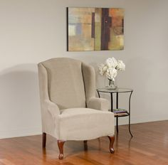Dimples Mink Wing Chair. Dimple embossed pattern upholstery, beige form fit slip cover design, living room, beautiful interior design, chic home decor