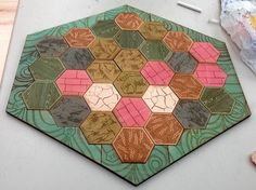 A handmade Settlers board! To Craft Into a Board Game: There are a lot of board game DIYs on reddit, and this Settlers of Catan game created by laurology is one of the best examples. Source: imgur user laurology