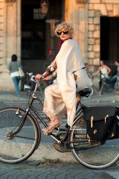 Of course French women are chic, even while riding a bike.