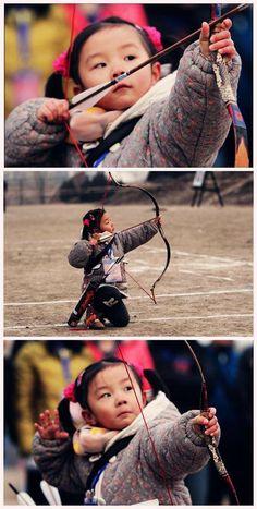 Adorable Mongolian girl archer sport list for children: http://www.topendsports.com/sport/sport-list.htm
