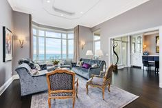 For sale: $5,250,000. Overlooking Lake Michigan with astonishing eastern views of the city, this incredible Lincoln Park residence offers custom details, beautiful built-ins and seamless finishes at every turn. Professionally designed throughout, this unit lives like a 5,000 square foot home and is perfect for living and entertaining. The luxurious master bedroom, gorgeous library, formal living room, kitchen and breakfast room offer exceptional east-facing views of the lake and city. The…