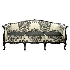 Gently used settee with damask upholstery and carved detail.      Product: SetteeConstruction Material: Wood and fabri...