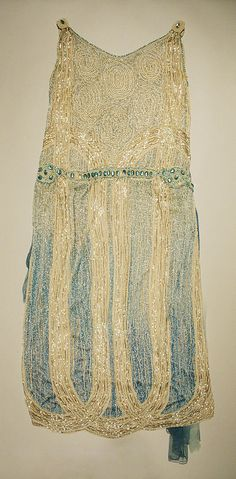 Evening dress Date: 1924 Culture: American Medium: cotton, silk, beads Dimensions: Length at CB: 47 in. (119.4 cm) Credit Line: Gift of Mrs....