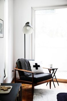 This looks like it should be in a home where the people climb mountains.  Cool, minimal and chic paired with cheap-o Ikea light is an added bonus!  via @MyDomaine Living Room Lighting, Ikea Lighting, Modern Lighting, Lighting Ideas, Interior Lighting, Lighting Design, Ikea Floor Lamp, Bedroom Floor Lamps, Bedside Lamp
