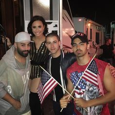 Demi Lovato Squeezes Herself Into Nick Jonas And Joe Jonas' Of July… Demi And Joe, Demi Lovato Style, Boston Pops, Wilmer Valderrama, Jonas Brothers, Nick Jonas, Iconic Women, Delena, Her Music