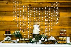 Sweet desert table with hanging garland backdrop | Autumn Cutaia Photography