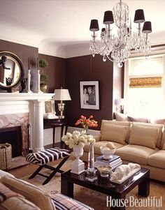 I love the chandelier and the neutral furniture mixed in with the animal print and the bold dark walls, It has a tradition feel with some modern elegance, If you are having difficulty figuring out how to decorate your living room. Check out these 10 living rooms that are sure to inspire you.