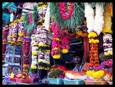 Fresh flowers made into garlands to offer Gods at a local temple.  Near the Siddhi Vinayak temple, Mumbai, India by tanya-n.deviantart.com