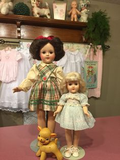 These are Toni dolls by ideal from the early 1950's. The small one is marked p-90 and the taller one is p-93, both in original tagged clothing.