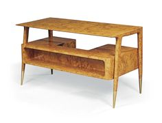 GIO PONTI (1891-1979) AN IMPORTANT DESK, 1951 executed by Giordano Chiesa, Ferrara-walnut, metal pulls, the tapering legs with brass sabots 30 3/8 in. (77.2 cm.) high; 55 1/8 in. (140 cm.) wide; 25 5/8 in. (65 cm.) deep