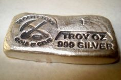"""Hand poured 1 troy ounce silver bar. Hand stamped """"One Troy Ounce .999 Silver"""