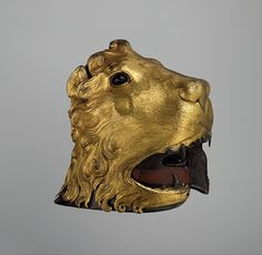 This helmet in the shape of a lion's head is the oldest surviving example of Renaissance armor all'anitca (in the antique style)  Date: ca. 1475–80 Culture: Italian Medium: Steel, copper, gold, glass, pigments, textile Dimensions: H. 11 3/4 in. (29.8 cm); W. 8 1/4 in. (21 cm); D. 12 1/2 in. (31.8 cm); Wt. 7 lb. 14 oz. (3574 g) Classification: Helmets