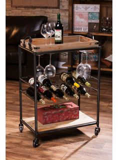 "Rustic Wine Cart from WineRacks.com. $394.00  Dimensions: 29"" w x 15.75"" d x 37.35"" h Capacity: 10 bottles  This rustic wood and metal wine cart has a removeable tray on the top for serving.  Stores 10 wine bottles and stemware."