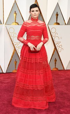 2017 Oscars: Ginnifer Goodwin is wearing a red sheer Zuhair Murad long sleeve gown. This dress is gorgeous on Ginnifer! I like the color and the sheer cutouts!