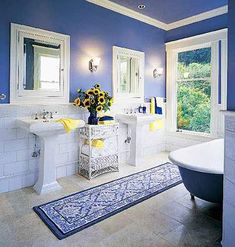 More Space in the Bath The two pedestal sinks in this 1908 bathroom leave most of the new limestone floor exposed, accentuating the room's volume. The 8-foot-wide room retains the original medicine cabinets and claw-foot tub. Formal white molding contrasts vividly with rish azure walls.