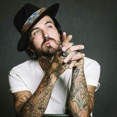 Currently obsessed with Yelawolf and his work. His tattoos fascinate me.