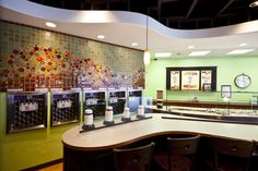 Soyo Frozen Yogurt Shop features mosaic tile on the walls.