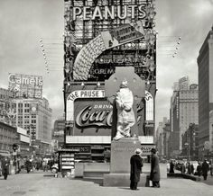 "New York, 1937. ""Times Square with Father Duffy statue still wrapped up."" Sculptor Charles Keck's likeness of Francis P. Duffy, the New York Army National Guard chaplain decorated for his service in France with the 69th Infantry Regiment during World War I. Duffy Square and the statue were dedicated on May 2, 1937, by Mayor LaGuardia. Photo by Peter Sekaer."