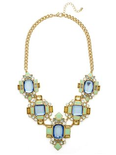 This regal bib is brimming with vintage glamor, from its geometric arrangement of jaw-dropping gems and multicolored stone work to its pretty enamel accents, this bib makes a downright royal statement.