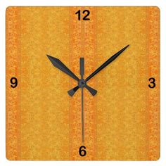 """""""Floral Stripe Bathed in Yellow and Orange Sunshine"""": What a happy clock this is with its flower rows defined by rich yellows and oranges. Whether in the kitchen, the bedroom, the bathroom, the family room, the living room, or anywhere else, it's like hanging sunshine on the wall."""