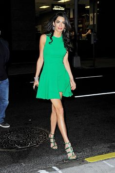 Amal Clooney wears a kelly green mini dress with caged leather sandals
