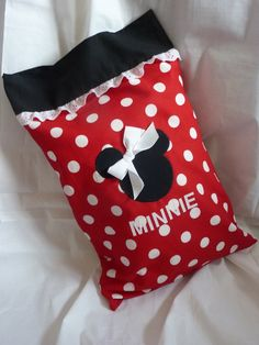 Minnie Mouse Boutique Toddler/travel size pillow with pillowcase. $15.00, via Etsy.