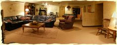 Family/Game Room with space for a poker style round table, exercise equip. TV and seating.