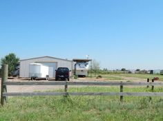 30 x 40 metal building with office and half bath. Sidewalls are 10' with an 9' overhead door. Lean to on the east side of building and a small fenced back yard area. Two out buildings that would be great horse stalls!  Property has well, septic on 2 acres.  Sold with R005 1000 0025.  This property has no restrictions!  Great for living, small business, or storage! The sky is the limit!