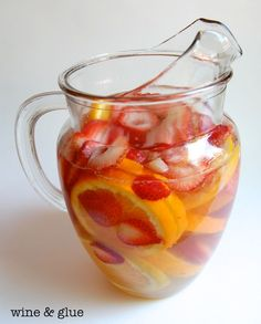 Sunset Sangria pound strawberries, hulled and sliced 3 medium navel oranges, sliced cup citrus rum 2 oz orange liquor a bottle of Moscoto lemon-lime soda Mix the wine, rum, and orange liquor. Party Drinks, Cocktail Drinks, Fun Drinks, Cocktail Recipes, Alcoholic Drinks, Beverages, Fruity Drinks, Sangria Wine, White Sangria