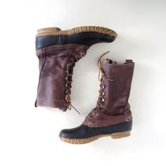 1970s L.L. Bean tall boots--or Maine Hunting Shoes--with black rubber vamps and brown leather shafts.