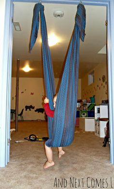 "Post-babywearing woven wrap use: sensory-friendly ""hugging"" swing! Sensory Swing, Sensory Tubs, Sensory Rooms, Sensory Activities, Activities For Kids, Sensory Play, Sensory Lights, Sensory Motor, Sewing For Kids"