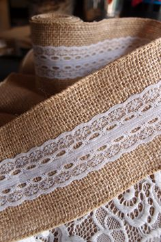 Burlap fabric ribbon with lace on one side. Measures a little over wide x 6 feet. This natural burlap ribbon with lace overlay can be used to wrap mason jars and vase as well. Burlap Fabric, Burlap Lace, Burlap Ribbon, Fabric Ribbon, Lace Ribbon, Christening Decorations, Diy Wedding Decorations, Diy Decoration, Lace Runner