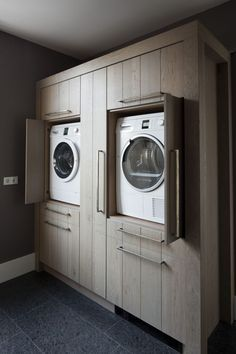 Laundry machines at just the right height! Lifting the machines and building custom cabinets is better for our mental and physical well-being.