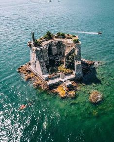 Cinque Terre Italy island house Is it a castle or a house? Whatever it is we'd love to spend a week on this private island in Cinque Terre Italy… guessing we can't afford it though so Glamping it is! Places Around The World, The Places Youll Go, Places To See, Dream Vacations, Vacation Spots, Places To Travel, Travel Destinations, Amazing Destinations, Photos Voyages